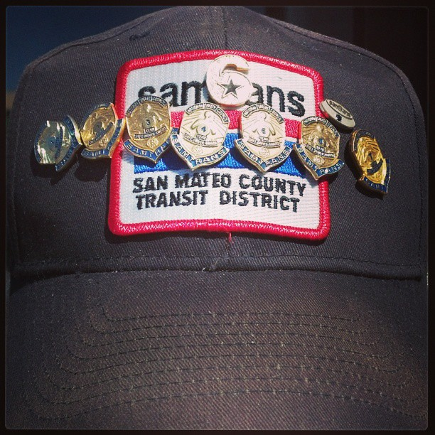On his SamTrans hat, Bailey wears a '6' pin that signifies to other vets that he's got their back, or 6 o'clock.