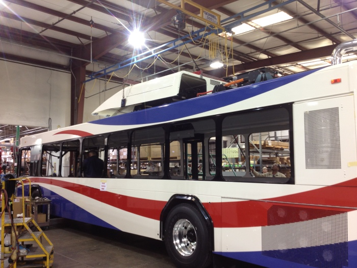 A new SamTrans hybrid bus nears completion.