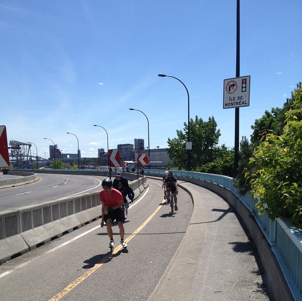 Cyclists enjoy the bike path across the St. Lawrence River.