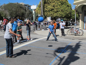 Kids play foursquare on the streets during a Sunday Streets event.