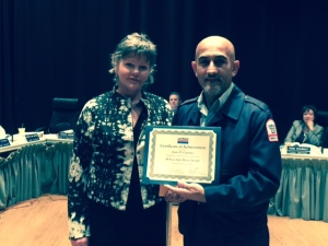 SamTrans Operator Juan Casiano is honored by board member Zoe Kersteen-Tucker for his 30-year Safe Driver Award.